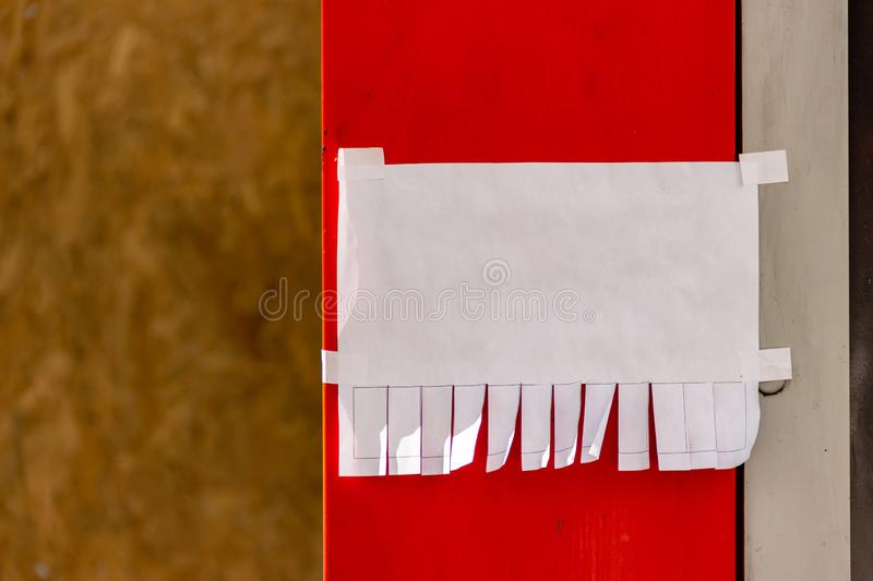 Mock up template. Street paper ad or announcement with tear-off stripes with phone number. Blank design. Natural sunny lighting royalty free stock photography