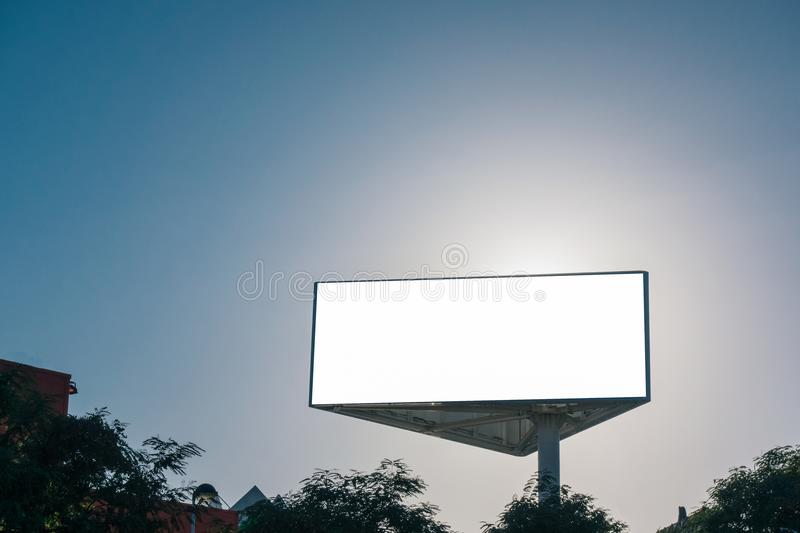 Mock up of triangle billboard or advertising poster with blue sky background. Mock up. Triangle billboard or advertising poster with blue sky background stock images