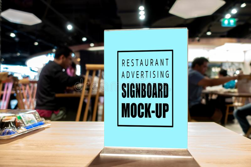 Mock up vertical advertising signboard acrylic frame in restaurant. Mock up blank perspective vertical advertising signboard in acrylic frame with clipping path stock photo