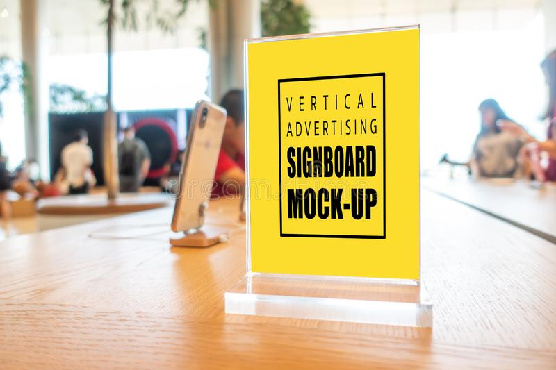 Mock up vertical advertising signboard acrylic frame in smartphone shop royalty free stock photos