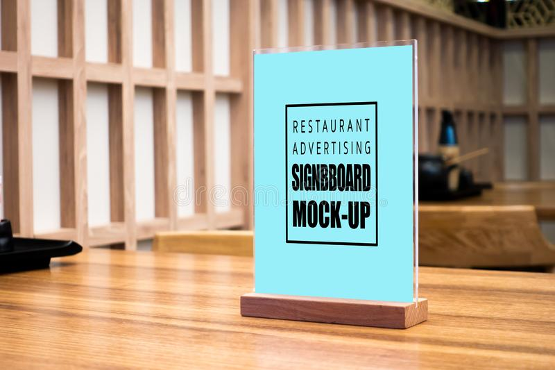 Mock up vertical advertising signboard in Japanese style restaurant. Mock up perspective blank vertical advertising signboard in acrylic frame with clipping path stock photos