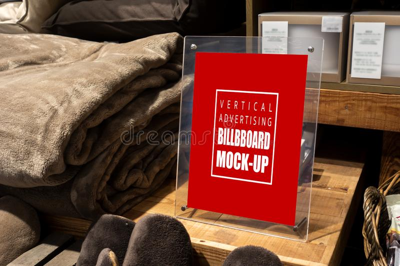 Mock up vertical banner in acrylic on wooden box. Mock up vertical blank banner in acrylic stand on wooden box with clipping path, near the wool folded and stock images