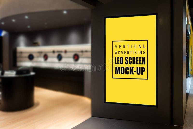 Mock up vertical LED screen at entrance IT Shop royalty free stock image