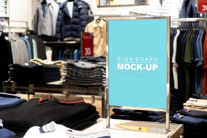 Mock up vertical signboard stand at shop clothing royalty free stock images