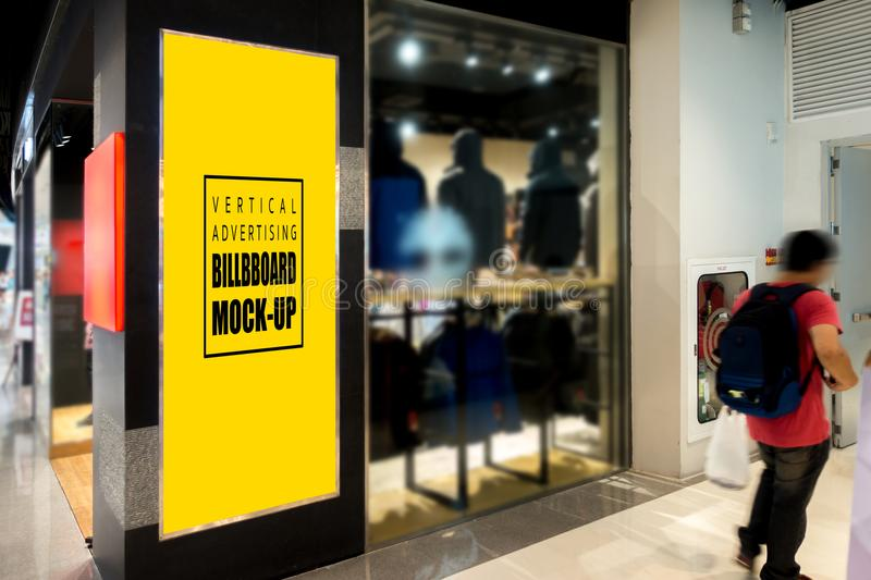 Mock up vertical signboard at the clothing store stock photography