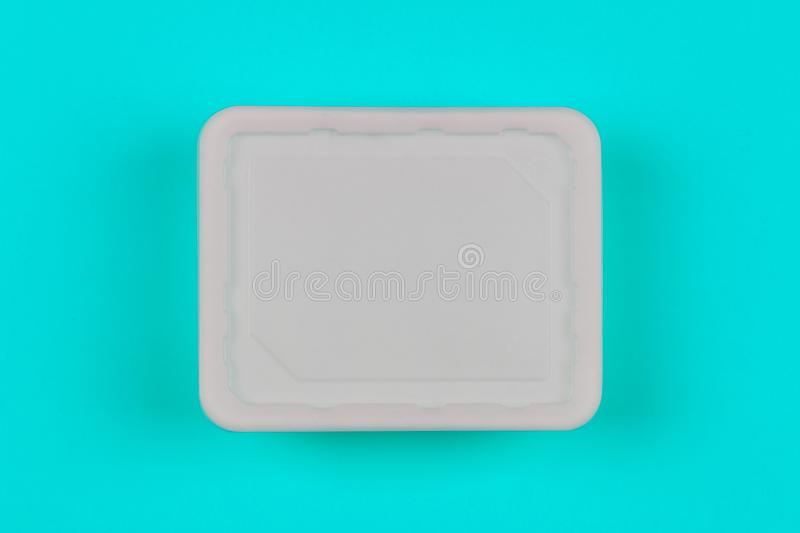 Mock-up white plastic box on blue background top view, disposable packaging for products stock photography