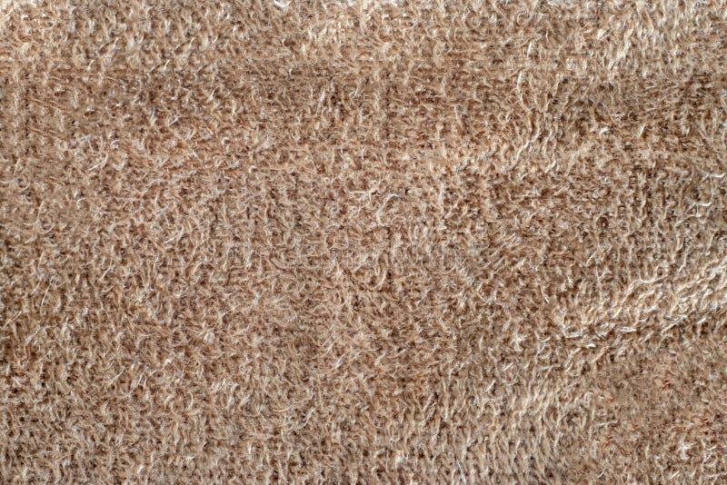 Mockaskinn för makrotexturbeiga bakgrund för läder för closeupsämskskinn mjuk arkivbild