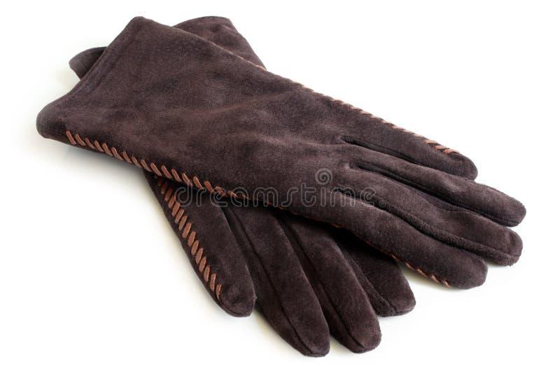 Mockaskinnkvinnors handskar arkivfoto
