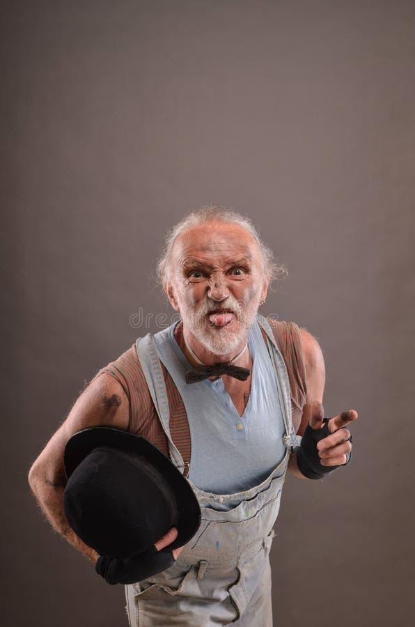 Mocking old beggar stock photos