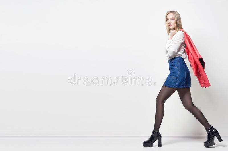 Mockup Beautiful blond woman in shirt and skirt. Girl with perfect body posing standing. Beautiful long hair and legs, smooth. Clean skin, skin care and hair royalty free stock photos