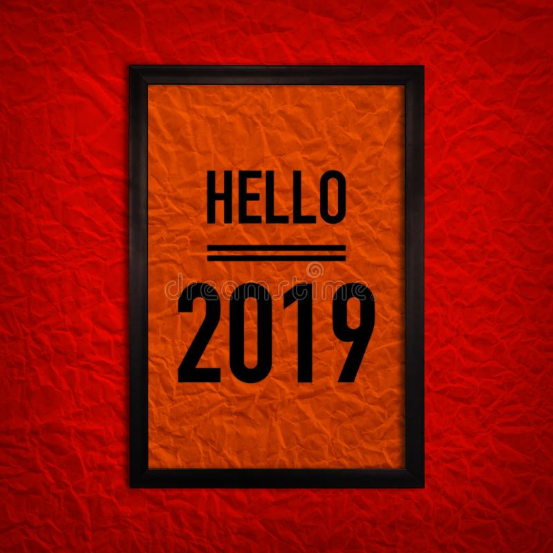 Mockup black frame on red paper texture with text hello 2019. Mockup of black frame on red paper texture with text hello 2019 royalty free stock photography