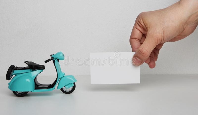 Mockup of blank business card and retro scooter on blank background mockup of blank business card and retro scooter on blank background business empty mock up background for text message writinghorizontal colourmoves