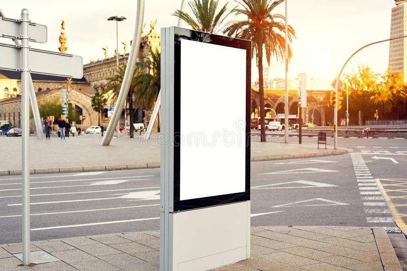 Mockup of a blank empty advertising urban billboard, placeholder template on city street, space for design layout, sunset light. Mockup of a blank empty royalty free stock photography