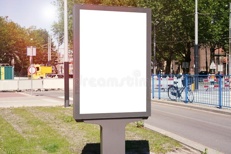 Mockup of a blank empty white advertising urban billboard, placeholder template city street, space for design layout. Mockup of a blank empty white advertising stock photography