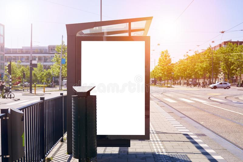 Mockup of a blank empty white advertising urban billboard, placeholder template city street, space for design layout, sunset light.  stock images