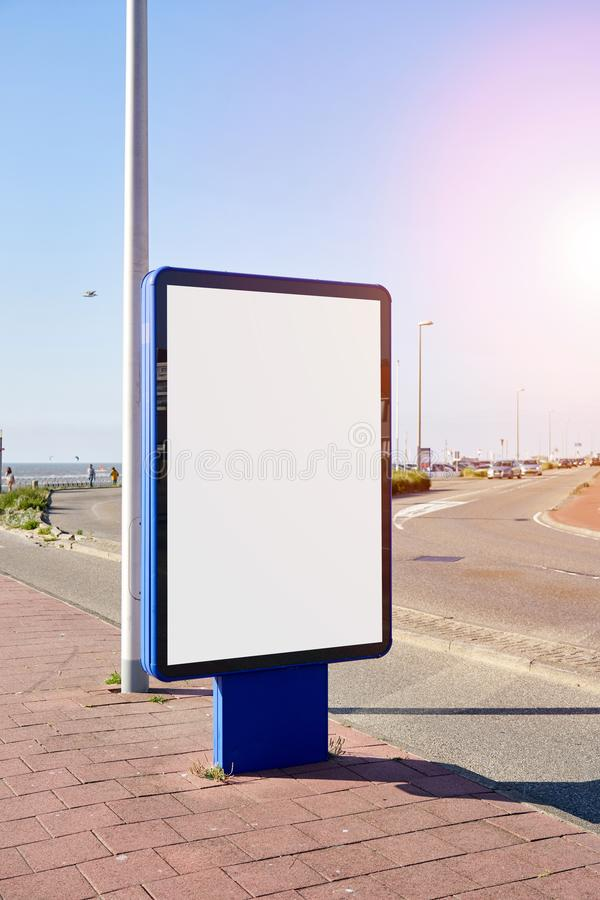 Mockup of a blank empty white advertising urban billboard at seaside on the street, space for design layout. Mockup of a blank empty white advertising urban stock photography