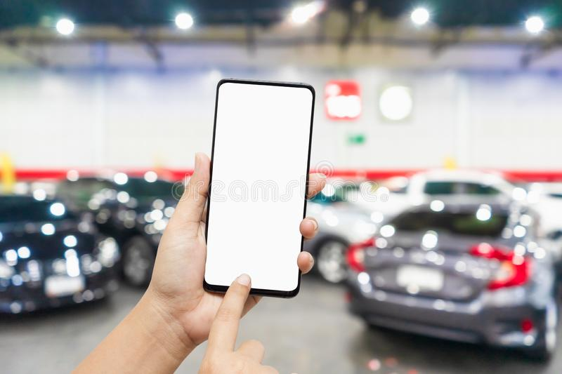 Mockup blank screen mobile phone for app or web site mockup promotion. Ideal for auto dealership, automobile service online, smart. Car concept, Car shopping royalty free stock photography