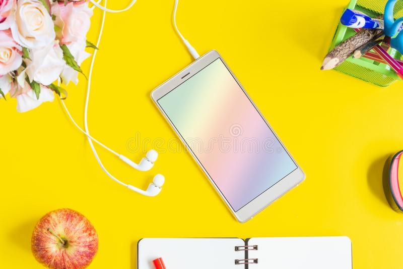 Mockup blank screen mobile phone. Flat lay yellow background office home working space royalty free stock photography