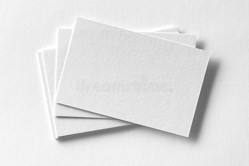 Mockup of business cards fan stack at white textured paper royalty free stock photography