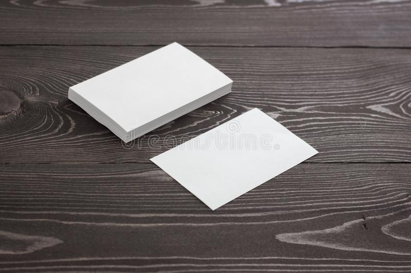 Mockup of business cards, Photo of business cards stack on a dark wood background royalty free stock photography