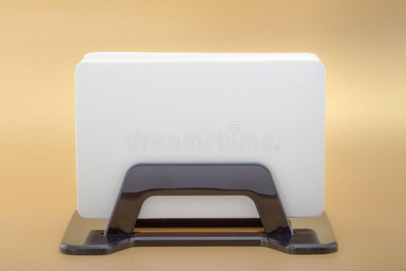 Mockup business template visit card in card holder on orange background. stock photos