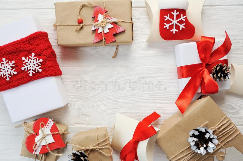 Mockup Christmas background - Christmas present red gifts box and decorating elements on white wooden background stock photo