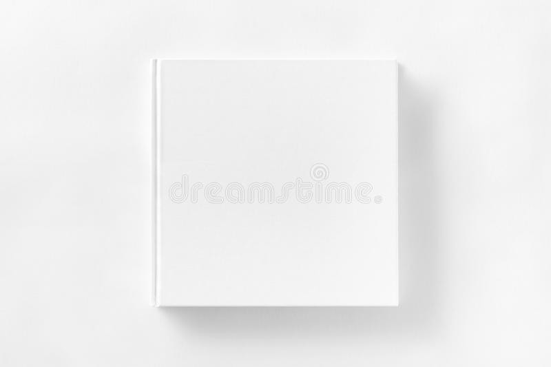 Mockup of closed blank square book at white textured paper royalty free stock photos
