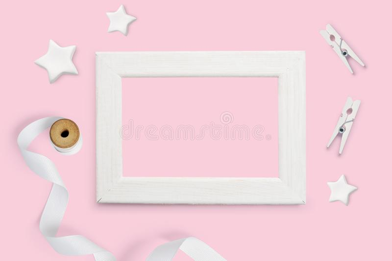 Mockup decorative background white wooden frame and white stars top view and place for text on a pink paper background stock photo