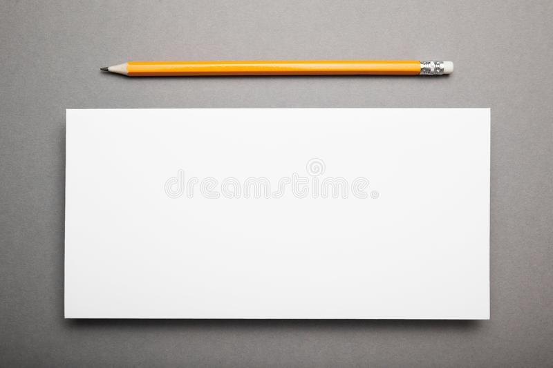 Mockup DL Flyer with pencil on a gray background.  stock photo