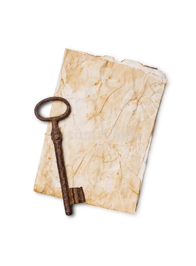Mock up of empty old vintage yellowed paper sheet and rust key. Mockup of empty old vintage yellowed paper sheet and rusty key isolated on background royalty free stock images