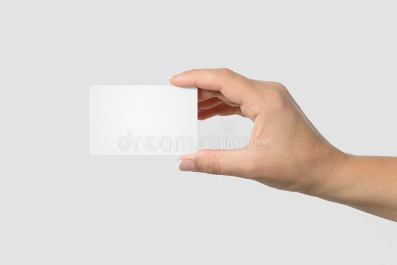 Mockup of female hand holding a business card on light grey mockup of female hand holding a business card on light grey background size 85x 55 mm reheart Choice Image