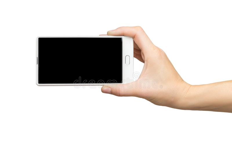 Mockup of female hand holding frameless cell phone with black screen stock image