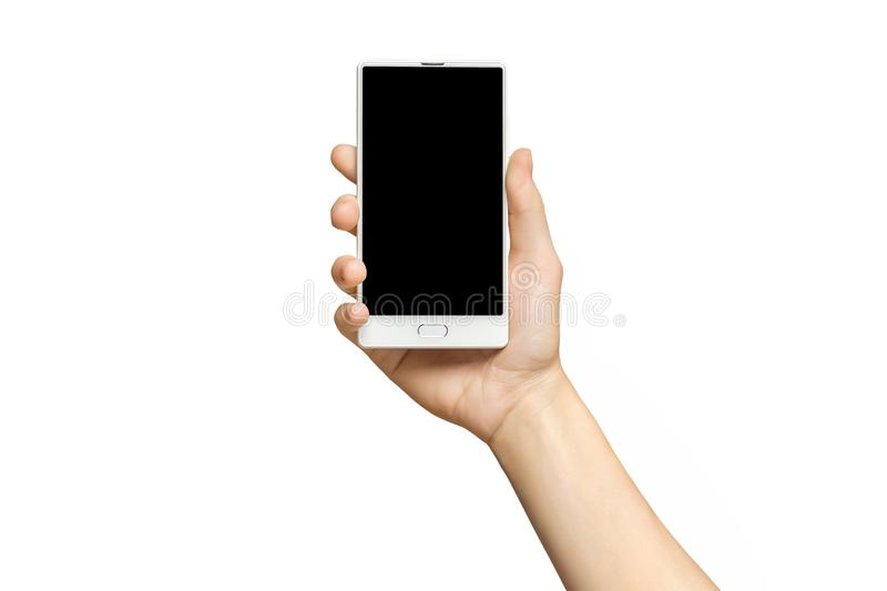 Mockup of female hand holding frameless cell phone with blank screen royalty free stock photography