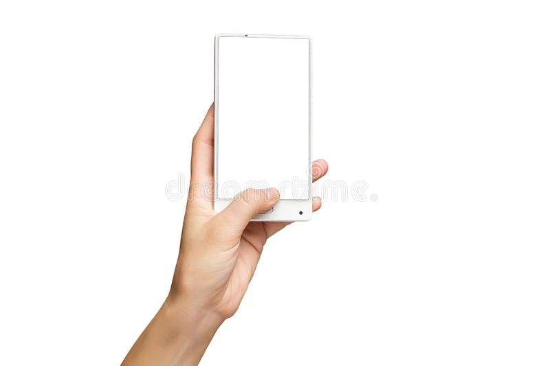 Mockup of female hand holding frameless cell phone with blank screen stock photo