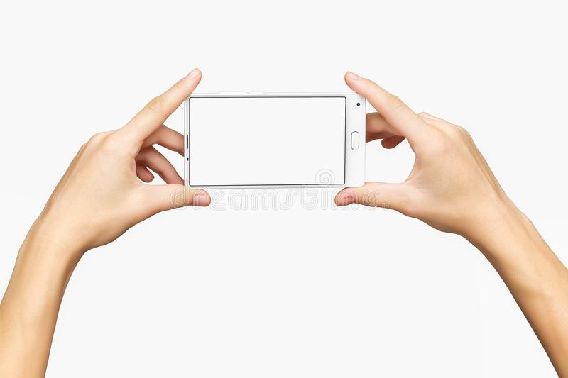 Mockup of female hands holding cellphone with white screen royalty free stock photos