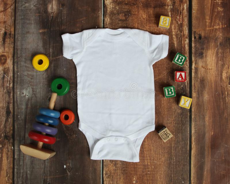 Mockup Flat Lay of white baby bodysuit shirt royalty free stock images