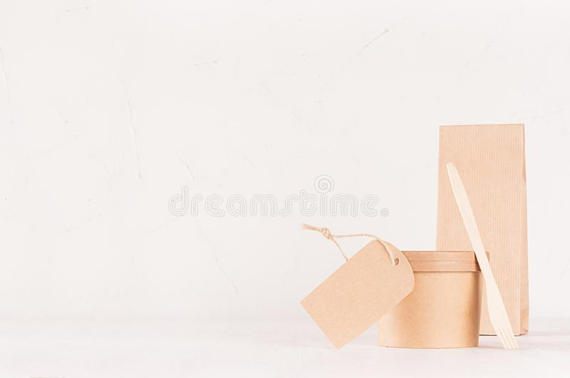 Mockup food takeaway packaging for cafe and restaurant - blank label, container for food, packet, spoon of brown paper on white. Mockup food takeaway packaging royalty free stock images