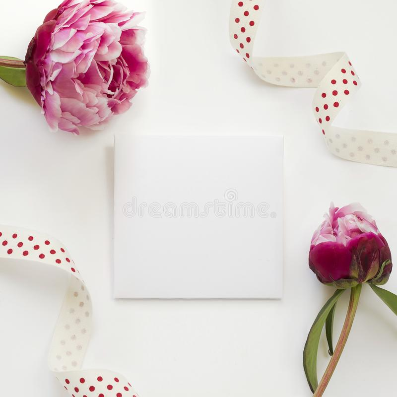 Greeting card template decorated by peony flowers and polka-dot ribbon. Mockup of greeting card for displaying your design: for weddings, parties, birthdays and stock photography