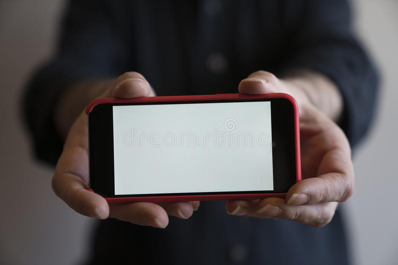 Mockup hands red color phone mock up screen holding display blank white. Mockup hands phone mock up screen holding display blank white stock photo
