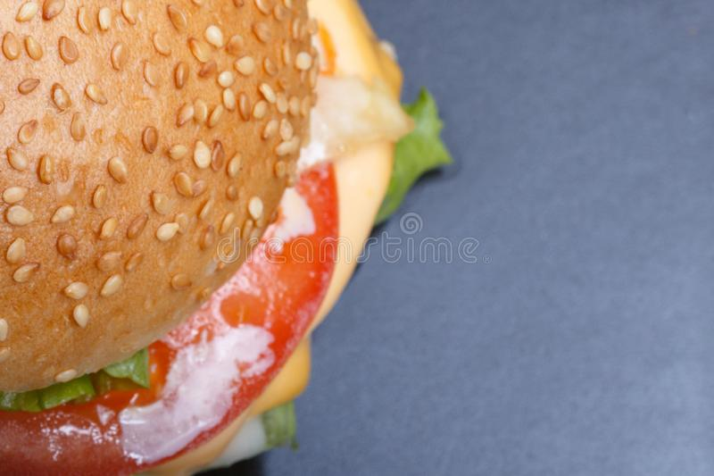 Mockup for home-made hamburger with sesame bun and ingredients of your own invention stock photography