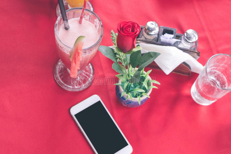 Mockup image of white mobile phone with blank white screen on red background in restaurant. Tropical Bali island stock images