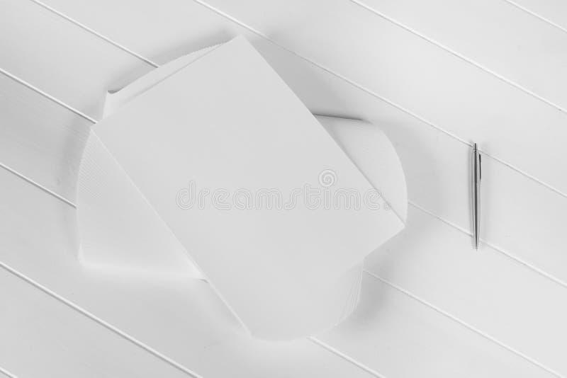 Mockup magazine, poster, brochure or flyer isolated on white background. Mockup of magazine, poster, A4 brochure, catalog or flyer isolated on white wooden stock images