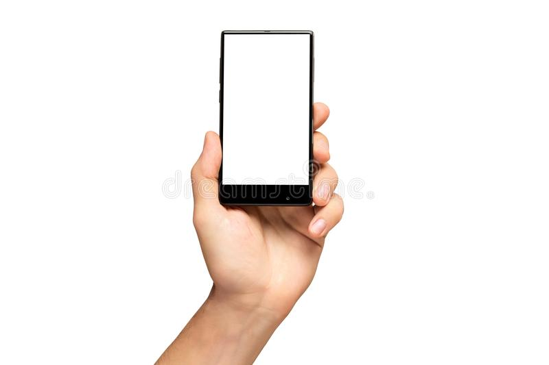 Mockup of male hand holding black cell phone. Mockup of male hand holding black frameless cell phone with black screen isolated at white background stock images