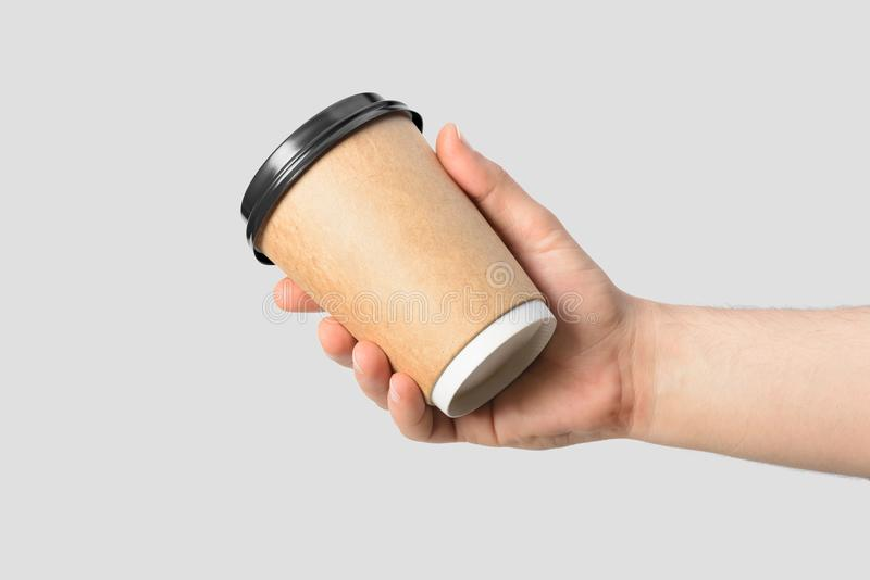 Mockup of male hand holding a Coffee paper cup. royalty free stock photography