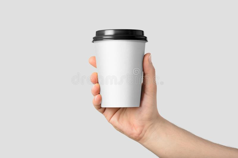 Mockup of male hand holding a Coffee paper cup. stock images
