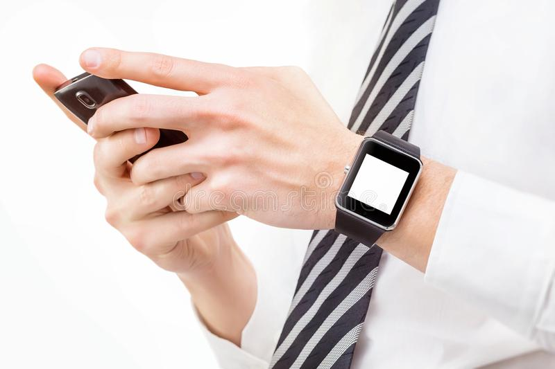 Mockup of male hands holding cellphone and smart watch isolated. At white background stock image