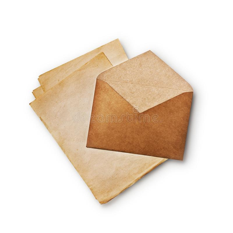 Mock up of old vintage kraft envelope and empty paper sheets royalty free stock photo