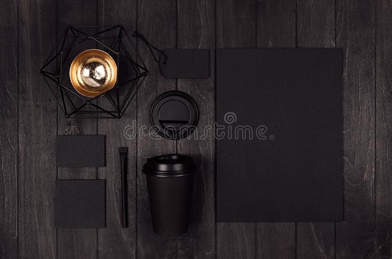 Mockup packing for coffee products and shop - black paper cup, blank paper, label, card, stationery, golden six-pointed star. royalty free stock image