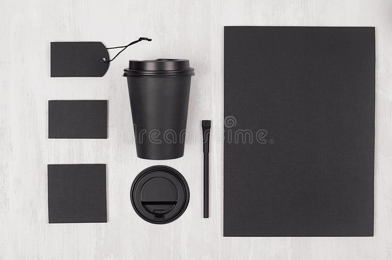 Mockup packing for coffee products and shop - black paper cup, blank paper, stationery, sugar on white wood table, top view. Mockup packing for coffee products stock image