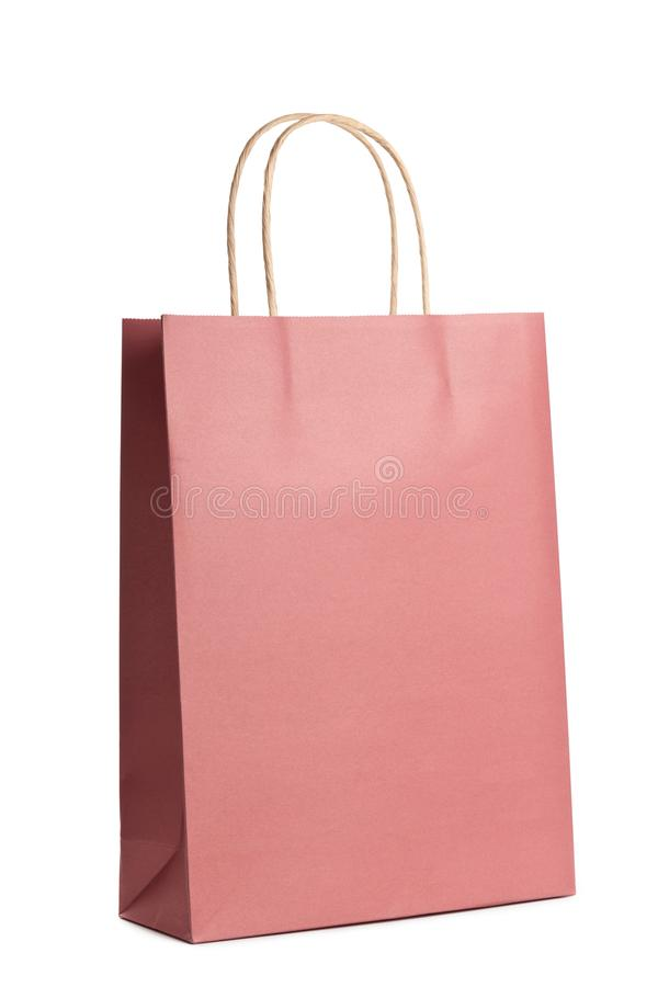 Mockup of paper shopping bag isolated on white background. Packet for gift or present. Mockup of paper shopping bag isolated on white background. Packet for royalty free stock images